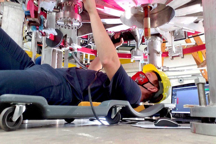 Makerspace Staff Member Clayton Custer 3D scanning the Pegasus III Plasma Chamber