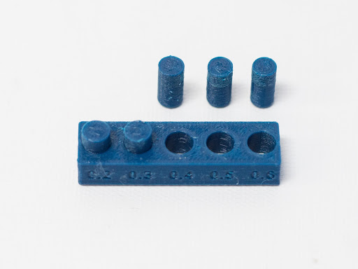 Picture pf 3D printed pegs showing precision of printing