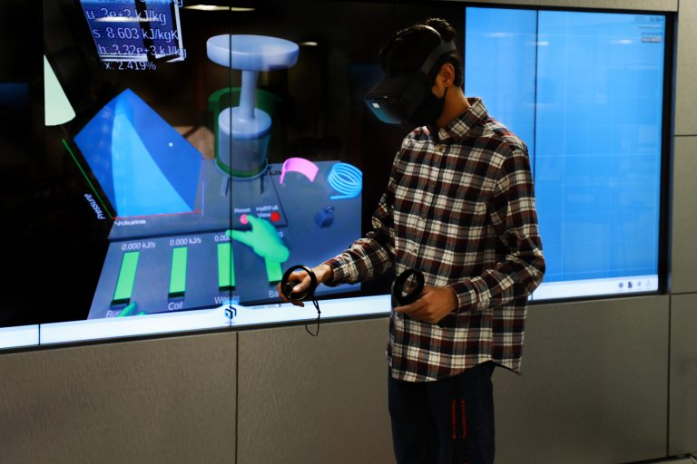 Student using VR equipment in Kohler Innovation Visualization Studio